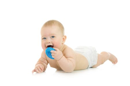 Laying small baby with a toy isolated over white Stock Photo - 4437997