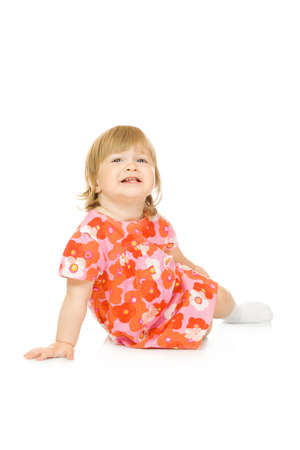 careless: Small sitting baby in red dress isolated Stock Photo