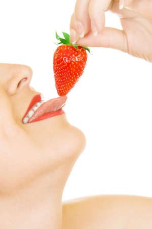 Young girl eat strawberry isolated Stock Photo - 4935410