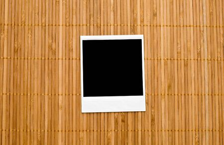 Blank photo frame on bamboo background photo