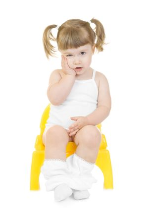 the piss: Little curious girl on chamberpot isolated background