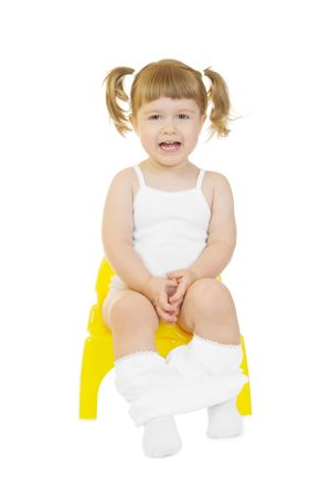Little curious girl on chamberpot isolated background photo