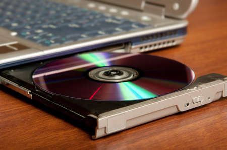 Compact disc on drive Stock Photo - 7707423
