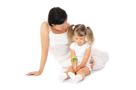 Little smiling girl with mother isolated Stock Photo - 7872253