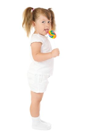 Little girl with lollipop isolated photo