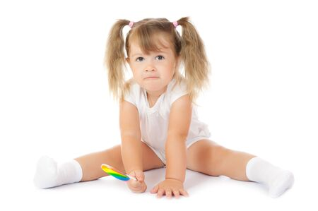 Small smiling girl with lollipop isolated Stock Photo - 7986906
