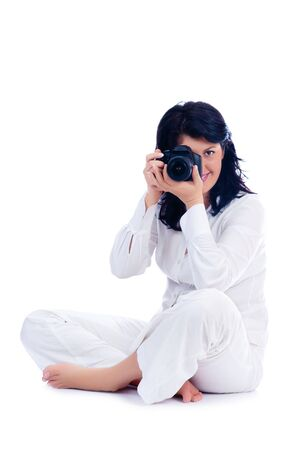 Young girl with DSLR isolated photo