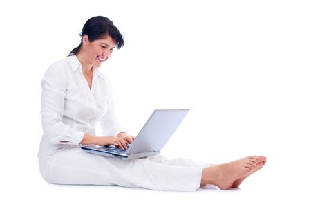 Young woman with laptop isolated photo