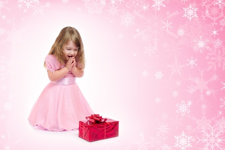 Little smiling girl with gift box photo