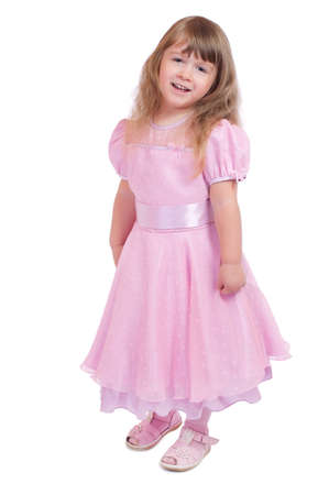 Little smiling girl in pink dress isolated photo