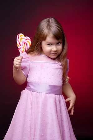 Little smiling girl with lollipop photo