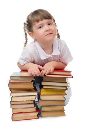Little girl with books isolated photo