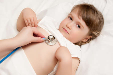 Listening of little girl by stethoscope Stock Photo - 9608226