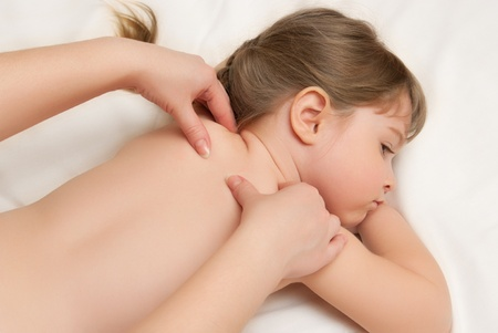 woman does massage to the little girl