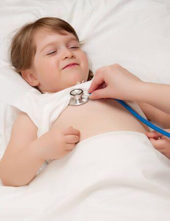 Listen by stethoscope little smiling girl Stock Photo - 9608236
