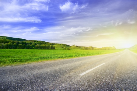 Asphalt rural road to sunrise Stock Photo - 9646901