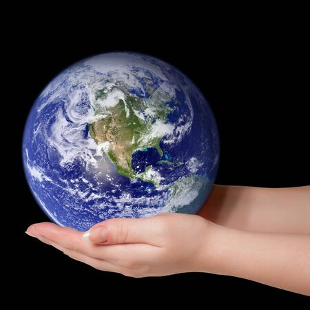 Woman holding in palms earth globe photo