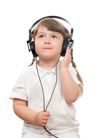 Little girl listen music by ear-phones  photo