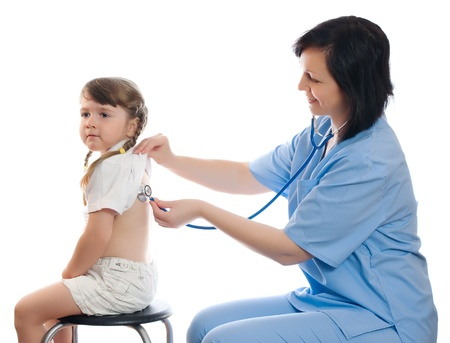 pediatrics: doctor listens by stethoscope little girl