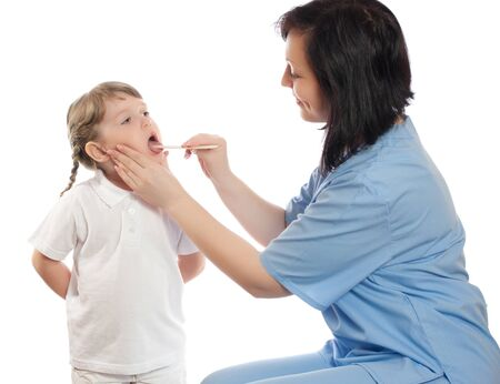 Doctor check throat of little girl photo