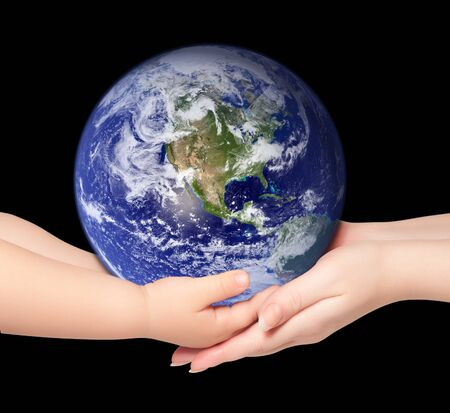 Child and woman holds earth globe on black photo