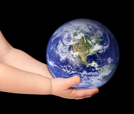 Little girl hold globe on black photo