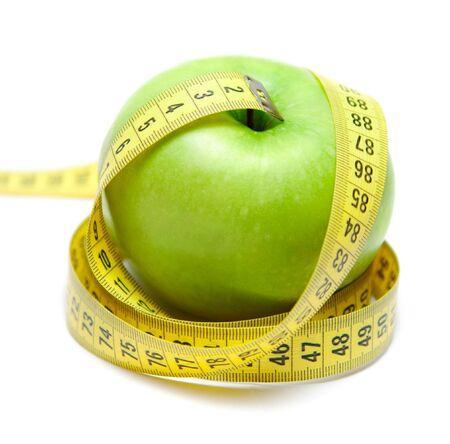 Green apple with centimeter tape Archivio Fotografico