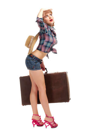 Young woman with suitcase isolated Stock Photo - 9851391