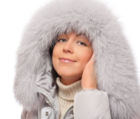Portrait of young woman in fluffy hood photo