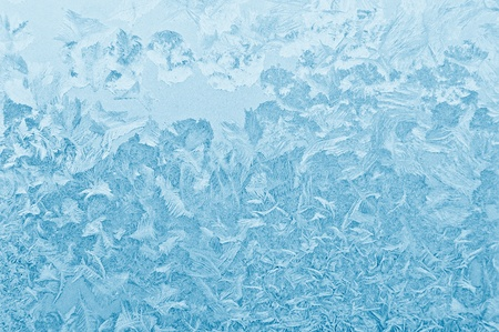 hoar frost: Blue frozen glass winter background