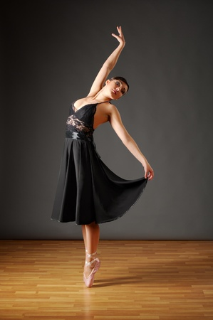 Young dancing ballerina in black costume photo