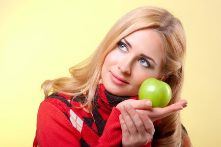 Young smiling woman with apple photo