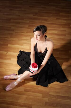 Young ballerina in black costume photo