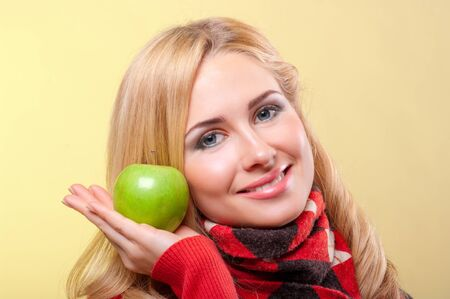 Young woman with green apple photo