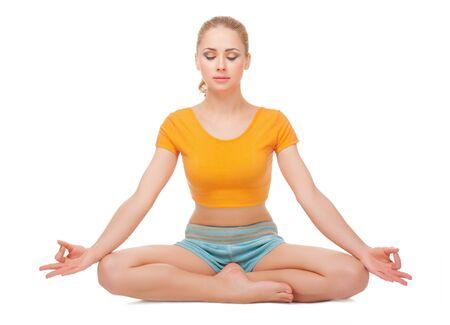 Young woman doing gymnastic exercises isolated photo