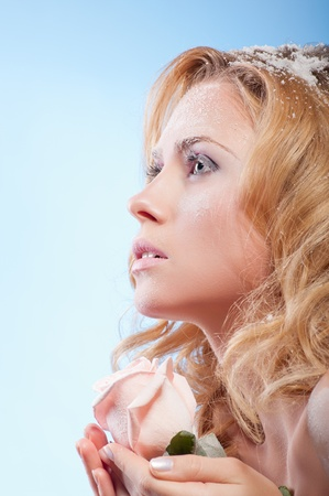 Young beautiful woman with snowy skin (warm colors) photo