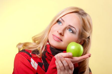Young woman with green apple Stock Photo - 11583864
