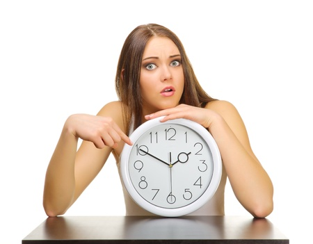Young girl with clocks isolated photo