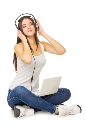 Young girl listening misoc by headphones isolated