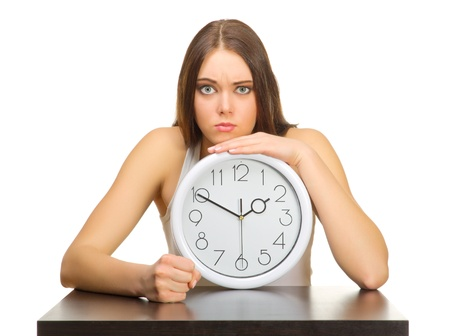 Young angry girl with clocks isolated Archivio Fotografico