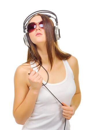 Young girl hear music by headphones isolated photo
