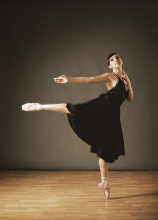 Young ballerina in black costume (ancient style) photo