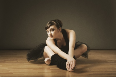 Young ballerina in black costume (ancient style) Stock Photo - 12079256