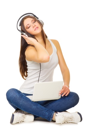 Young girl listen music by headphones isolated photo