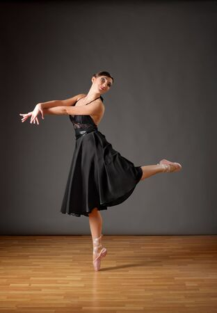 pointes: Young ballerina in black costume