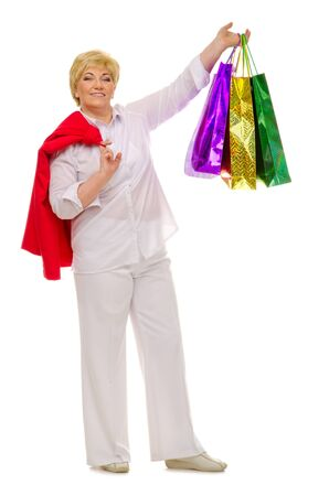 Happy standing senior woman with packets isolated photo