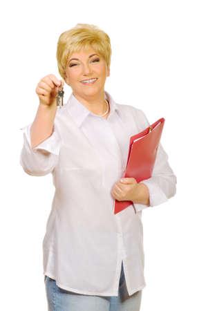 Senior woman with keys and folder isolated photo
