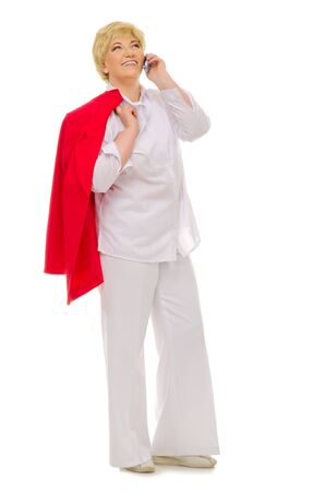 Senior woman talking by mobile phone isolated photo