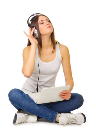 Young girl listen music isolated photo