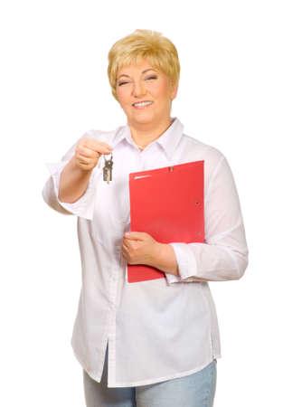 Happy senior woman with keys isolated photo